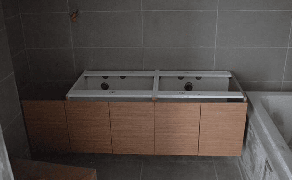 Marassi Residences - Bathroom vanity counters being installed, February 2018