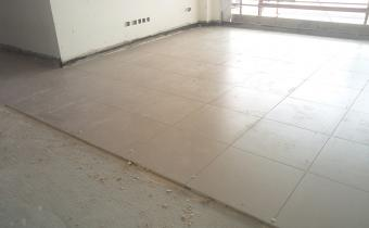 Floor Finishing- Tiling work is in progress in individual apartment units