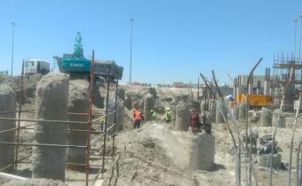 Excavation and pile trimming in progress, April 2019